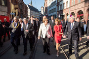 (L-R) The Lord Mayor of Frankfurt am Main Peter Feldmann, German President Joachim Gauck, German Chancellor Angela Merkel, Ursula Bouffier and Prime Minister of Hesse Volker Bouffier arrive for events to celebrate the 25th anniversary of German reunification on October 3, 2015 in Frankfurt, Germany. On October 3, 1990, following the end of the Cold War, western-oriented, capitalist and democratic West Germany and post-revolution, formerly communist East Germany reunited into a single state after 41 years of official separation. Though the integration of the two former states into one is seen by most as a success, differences remain, particularly in average incomes and pensions, which in eastern Germany are lower.