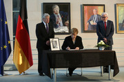 (L to R)  German President Joachim Gauck, German Chancellor Angela Merkel and Foreign Minister Frank-Walter Steinmeier (SPD) sign a condolence book for former German Chancellor Helmut Schmidt following his death the day before, in the German federal Chancellery on November 11, 2015 in Berlin, Germany. Schmidt, a German Social Democrat (SPD), led West Germany as chancellor from 1974 until 1982. He died in Hamburg at the age of 96.