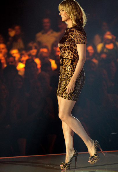 Heidi Klum walks on the catwalk during the 'Germany's Next Top Model Finals' at the Lanxess Arena on June 10, 2010 in Cologne, Germany.
