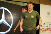 Toni Kroos (R) of Germany and team mate Thomas Mueller (L) arrive at a press conference ahead of their international friendly match against England at Mercedes Benz am Salzufer on March 24, 2016 in Berlin, Germany.