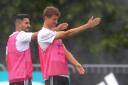 Thomas Mueller reacts with Ilkay Guendogan during the Germany training session ahead of the 2018 FIFA World Cup at CSKA Sports Base on June 13, 2018 in Moscow, Russia.
