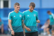 Toni Kroos of Germany speaks with Thomas Mueller of Germany during a Germany training session at Electron Stadium on June 26, 2018 in Kazan, Russia.