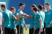 Mats Hummels of Germany jokes with his team mate Thomas Mueller during the Germany training session ahead of the 2018 FIFA World Cup at CSKA Sports Base Vatutinki on on June 15, 2018 in Moscow, Russia.