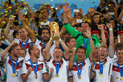 Bastian Schweinsteiger of Germany lifts the World Cup trophy with teammates after defeating Argentina 1-0 in extra time during the 2014 FIFA World Cup Brazil Final match between Germany and Argentina at Maracana on July 13, 2014 in Rio de Janeiro, Brazil.