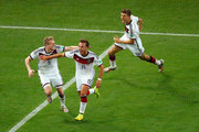 Mario Goetze of Germany (C) celebrates scoring his team's first goal in extra time with Andre Schuerrle (L) and Thomas Mueller during the 2014 FIFA World Cup Brazil Final match between Germany and Argentina at Maracana on July 13, 2014 in Rio de Janeiro, Brazil.