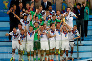 Philipp Lahm of Germany lifts the World Cup trophy with teammates after defeating Argentina 1-0 in extra time during the 2014 FIFA World Cup Brazil Final match between Germany and Argentina at Maracana on July 13, 2014 in Rio de Janeiro, Brazil.