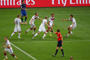 Mario Goetze of Germany (C) celebrates scoring his team's first goal in extra time with Benedikt Hoewedes, Thomas Mueller, Andre Schuerrle and Toni Kroos during the 2014 FIFA World Cup Brazil Final match between Germany and Argentina at Maracana on July 13, 2014 in Rio de Janeiro, Brazil.