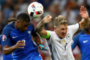 Retransmission with alternate crop.)  Bastian Schweinsteiger of Germany handles the ball off the head of Patrice Evra of France during the UEFA EURO semi final match between Germany and France at Stade Velodrome on July 7, 2016 in Marseille, France.