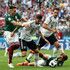 Javier Hernandez Mats Hummels Photos - Hector Herrera (l) and Javier Hernandez of Mexico (on floor) compete for the ball with Marvin Plattenhardt and Mats Hummels of Germany during the 2018 FIFA World Cup Russia group F match between Germany and Mexico at Luzhniki Stadium on June 17, 2018 in Moscow, Russia. - Germany vs. Mexico: Group F - 2018 FIFA World Cup Russia