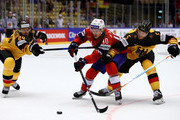 Dennis Seidenberg #24 and Korbinian Holzer #5 of Germany and Ken Andre Olimb of Norway battle for the puck during the 2018 IIHF Ice Hockey World Championship group stage game between Germany and Norway at Jyske Bank Boxen on May 6, 2018 in Herning, Denmark.