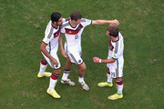 Sami Khedira of Germany, Thomas Mueller and Mario Goetze celebrate scoring their team's third goal during the 2014 FIFA World Cup Brazil Group G match between Germany and Portugal at Arena Fonte Nova on June 16, 2014 in Salvador, Brazil.