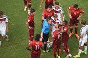 Raul Meireles of Portugal leads protest to referee Milorad Mazic during the 2014 FIFA World Cup Brazil Group G match between Germany and Portugal at Arena Fonte Nova on June 16, 2014 in Salvador, Brazil.