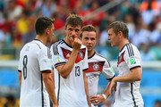 (L-R) Mesut Oezil of Germany, Thomas Mueller, Mario Goetze and Toni Kroos prepare to take a free kick during the 2014 FIFA World Cup Brazil Group G match between Germany and Portugal at Arena Fonte Nova on June 16, 2014 in Salvador, Brazil.