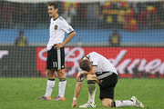 Bastian Schweinsteiger and Miroslav Klose of Germany show their dejection after being knocked out of the competition during the 2010 FIFA World Cup South Africa Semi Final match between Germany and Spain at Durban Stadium on July 7, 2010 in Durban, South Africa.