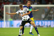 Thomas Mueller of Germany is tackled by Andreas Granqvist of Sweden  during the 2018 FIFA World Cup Russia group F match between Germany and Sweden at Fisht Stadium on June 23, 2018 in Sochi, Russia.