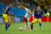 Julian Draxler of Germany challenge for the ball with Mikael Lustig and Viktor Claesson of Sweden  during the 2018 FIFA World Cup Russia group F match between Germany and Sweden at Fisht Stadium on June 23, 2018 in Sochi, Russia.
