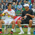 Kei Nishikori (L) and Ben McLachlan of Japan chat prior to their doubles match against Marcel Granollers of Spain and Robin Haase of the Netherlands during day two of the Gerry Weber Open at Gerry Weber Stadium on June 19, 2018 in Halle, Germany.