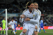 Sergio Ramos (L) of Real Madrid celebrates with team-mate Pepe after scoring his team's opening goal during the La Liga match between Getafe and Real Madrid at Coliseum Alfonso Perez stadium on February 4, 2012 in Getafe, Spain.