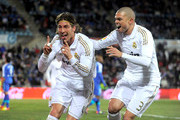 Sergio Ramos (L) and Pepe of Real Madrid celebrate after Ramos scored Real's opening goal against Getafe during the La Liga match between Getafe and Real Madrid at Coliseum Alfonso Perez stadium on February 4, 2012 in Getafe, Spain.  (Photo by Denis Doyle/Getty Images) at Coliseum Alfonso Perez on February 4, 2012 in Getafe, Spain.