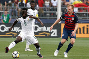 Mohammed Abu #6 of Ghana defends against United States Dax McCarty #13 of the United States in the first half during an international friendly between USA and Ghana at Pratt & Whitney Stadium on July 1, 2017 in East Hartford, Connecticut.