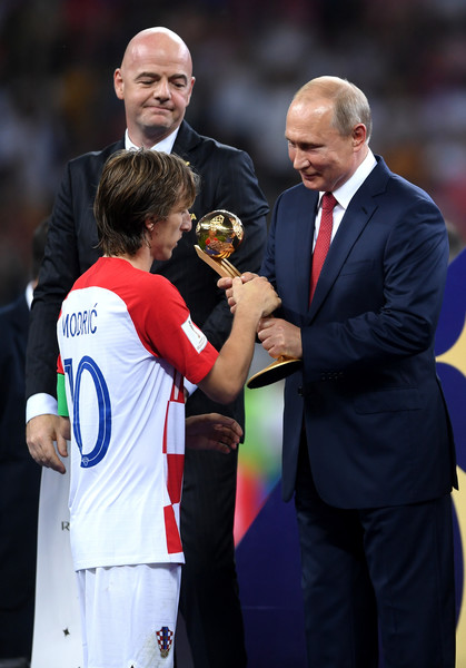 France v Croatia - 2018 FIFA World Cup Russia Final [player,team sport,sports,championship,coach,ball game,gesture,sports equipment,competition event,manager,valdimir putin,luka modric,award,russia,croatia,france,adidas golden ball,2018 fifa world cup,final,croatia - 2018 fifa world cup]