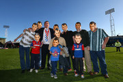 Martin Allen, Manager of Gillingham(4L) pose with fans after securing promotion during the npower League Two match between Gillingham and AFC Wimbledon at Priestfield Stadium on April 20, 2013 in Gillingham, England.