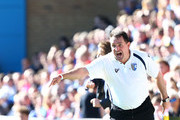 Martin Allen, Manager of Gillingham shouts orders during the npower League Two match between Gillingham and AFC Wimbledon at Priestfield Stadium on April 20, 2013 in Gillingham, England.