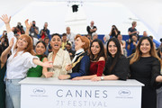 """Director Eva Husson (C) poses with actresses (L-R) Emmanuelle Bercot,  Evin Ahmad, Golshifteh Farahani, Mari Samidovi, Sinama Alievi and Roza Mirzoiani at the photocall for """"Girls Of The Sun (Les Filles Du Soleil)"""" during the 71st annual Cannes Film Festival at Palais des Festivals on May 13, 2018 in Cannes, France."""