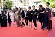 """Tonie Marshall (C) and filmmakers walk the red carpet in protest of the lack of female filmmakers honored throughout the history of the festival at the screening of """"Girls Of The Sun (Les Filles Du Soleil)"""" during the 71st annual Cannes Film Festival at the Palais des Festivals on May 12, 2018 in Cannes, France. Only 82 films in competition in the official selection have been directed by women since the inception of the Cannes Film Festival whereas 1,645 films in the past 71 years have been directed by men."""