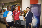 (EDITORIAL USE ONLY, NO SALES)  In this handout image provided by Glasgow 2014 Ltd, (L-R) BMX Ambassador Michael Pusey and James Cracknell hand over the Queen's Baton to Director of BBC Television Danny Cohen in the New Broadcasting House as it arrives in London on June 06, 2014 in London, England. England is nation 69 of 70 nations and territories the Queen's Baton will visit.