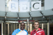 (EDITORIAL USE ONLY, NO SALES)  In this handout image provided by Glasgow 2014 Ltd, (L-R) BMX Ambassador Michael Pusey holds the Queen's Baton with James Cracknell outside the New Broadcasting House as it arrives in London on June 06, 2014 in London, England. England is nation 69 of 70 nations and territories the Queen's Baton will visit.