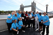 (EDITORIAL USE ONLY, NO SALES)  In this handout image provided by Glasgow 2014 Ltd, Mayor of London Boris Johnson, Olympic gold medalist Christine Ohurugu, Michael Pusey and Faramolu Johnson pose with Queen's Baton as it arrives in London on June 06, 2014 in London, England. England is nation 69 of 70 nations and territories the Queen's Baton will visit.