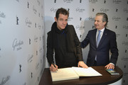 CEO of Glashuette Thomas Meier and President of the Berlinale International Jury Tom Tykwer attend the Glashuette Original Lounge at The 68th Berlinale International Film Festival at Grand Hyatt Hotel on February 15, 2018 in Berlin, Germany.