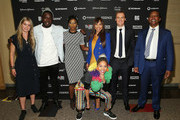 (L-R) Founder of Refugees for Refugees and My Name is Human Project Gemita Samarra, film producer Kweku Mandela, singer Tiwa Savage, Dr. Precious Moloi Motsepe of the Motsepe Foundation, CEO and Co-Founder of Global Citizen Hugh Evans, Patrice Motsepe of the Motsepe Foundation and singer Sho Madjozi (front row) pose for a photo during a press conference for the Global Citizen Festival: Mandela 100 at Sandton Convention Center on July 9, 2018 in Johannesburg, South Africa.
