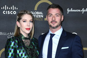 Katherine Ryan and Bobby Kootstra attend the Global Citizen Prize 2019 at Royal Albert Hall on December 13, 2019 in London, England.