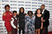 L-R Shunta Hutchins, Wendel Hutchins II, Aaniya Hutchins, DeOndra Dixon, Analise and Jamie Foxx on the red carpet at the Global Down Syndrome 10th anniversary BBBY fashion show at Sheraton Denver Downtown Hotel on October 20, 2018 in Denver, Colorado.