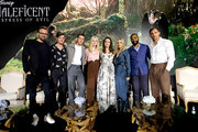 """(L-R) Director Joachim Ronning, actors Sam Riley, Harris Dickinson, Elle Fanning, Angelina Jolie, Michelle Pfeiffer, Chiwetel Ejiofor and Ed Skrein participate in the global press conference for """"Disney's Maleficent: Mistress of Evil"""" on September 30, 2019 in Beverly Hills, California."""