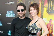 """Charlie Day (L) and Mary Elizabeth Ellis attend Global Road Entertainment's """"Hotel Artemis"""" premiere at Regency Village Theatre on May 19, 2018 in Westwood, California."""