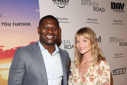 """LaDainian Tomlinson and Lindsay Pulsipher attend the """"God Bless The Broken Road"""" Premiere at Silver Screen Theater at the Pacific Design Center on September 5, 2018 in West Hollywood, California."""