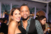 Guest and Cuba Gooding Jr. attend What Goes Around Comes Around 25th Anniversary Celebration At The Versace Mansion With a Retrospective Tribute To Gianni Versace on December 08, 2018 in Miami Beach, Florida.