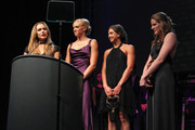 (L-R) Natalie Coughlin, Dana Vollmer, Rebecca Soni and Missy Franklin receive the Relay Performance Of The Year award at the 2011 Golden Goggles at JW Marriott Los Angeles at L.A. LIVE on November 20, 2011 in Los Angeles, California.