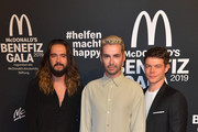 "Tom Kaulitz (l-r), musician, Bill Kaulitz, singer,  and Georg Listing, musician, attend the ""Golden Society - Family & Friends"" Charity Gala by McDonald's at Hotel Bayerischer Hof on November 09, 2019 in Munich, Germany."