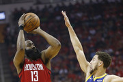 James Harden #13 of the Houston Rockets shoots over Klay Thompson #11 of the Golden State Warriors  during Game Six of the Western Conference Semifinals of the 2019 NBA Playoffs at Toyota Center on May 10, 2019 in Houston, Texas. NOTE TO USER: User expressly acknowledges and agrees that, by downloading and or using this photograph, User is consenting to the terms and conditions of the Getty Images License Agreement.