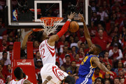 Festus Ezeli #31 of the Golden State Warriors has hi shot blocked by Dwight Howard #12 of the Houston Rockets as Patrick Beverley #2 and James Harden #13 looks on at Toyota Center on April 21, 2016 in Houston, Texas.  NOTE TO USER: User expressly acknowledges and agrees that, by dowloading and/or using this photograph, user is consenting to the terms and conditions of the Getty Images License Agreement.
