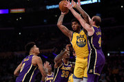 Marquese Chriss #32 of the Golden State Warriors passes as he is surrounded by Alex Caruso #4, Dwight Howard #39 and Kyle Kuzma #0 of the Los Angeles Lakers during the first half at Staples Center on November 13, 2019 in Los Angeles, California.  NOTE TO USER: User expressly acknowledges and agrees that, by downloading and/or using this photograph, user is consenting to the terms and conditions of the Getty Images License Agreement.