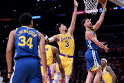 Klay Thompson #11 of the Golden State Warriors scores on a layup past Josh Hart #3 of the Los Angeles Lakers during a 130-111 Warriors win at Staples Center on January 21, 2019 in Los Angeles, California.  NOTE TO USER: User expressly acknowledges and agrees that, by downloading and or using this photograph, User is consenting to the terms and conditions of the Getty Images License Agreement.