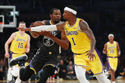 Kevin Durant #35 of the Golden State Warriors drives against Kentavious Caldwell-Pope #1 of the Los Angeles Lakers during the first half at Staples Center on April 04, 2019 in Los Angeles, California. NOTE TO USER: User expressly acknowledges and agrees that, by downloading and or using this photograph, User is consenting to the terms and conditions of the Getty Images License Agreement.