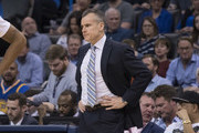Billy Donovan of the Oklahoma City Thunder watches game action during the second half of a NBA game against the Golden State Warriors at the Chesapeake Energy Arena on February 11, 2017 in Oklahoma City, Oklahoma.   NOTE TO USER: User expressly acknowledges and agrees that, by downloading and or using this photograph, User is consenting to the terms and conditions of the Getty Images License Agreement.