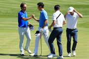 Edoardo Molinari of Italy and Renato Paratore of Italy celebrate victory as Michael Lorenzo-Vera of France and Romain Wattel of France react during Day One of the GolfSixes at The Centurion Club on May 5, 2018 in St Albans, England.