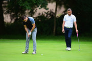 Craig Brown of Astbury Hall Golf Club putts as James Wright of Market Drayton Golf Club watches during the Golfbreaks.com PGA Fourball Championship Midland Qualifier at The Staffordshire Golf Club on July 4, 2017 in Stafford, England.
